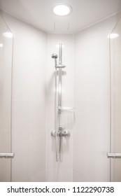 Interior of modern shower head in bathroom at home.Modern design of bathroom.White bathroom.Shower Head.
