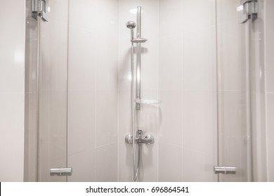 Interior of modern shower head in bathroom at home.Modern design of bathroom. White bathroom. Shower Head.