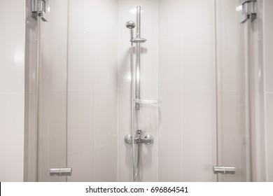 Interior of modern shower head in bathroom at home.Modern design of bathroom. White bathroom. Shower Head.