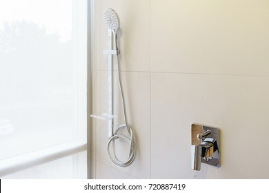 Interior of modern shower head in bathroom at home. Modern design of bathroom. White bathroom. Shower Head.