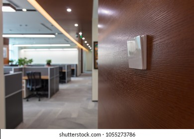 Interior of modern style office, power switch mounted on wall