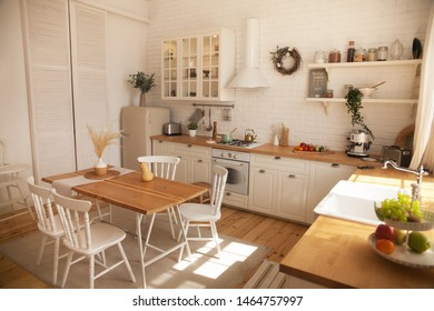 Interior of modern sunny kitchen in a Scandinavian-style apartment. Kitchen furniture, dishes, spices