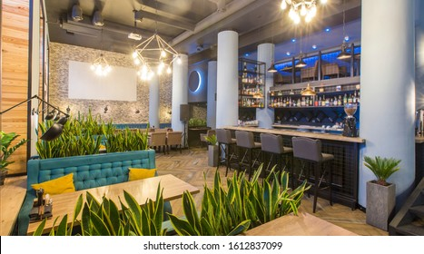 Interior of modern urban cafe or restaurant interior with dining places and bar counter, panorama, copy space
