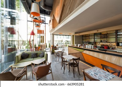Interior of a modern urban cafeteria with concrete floor