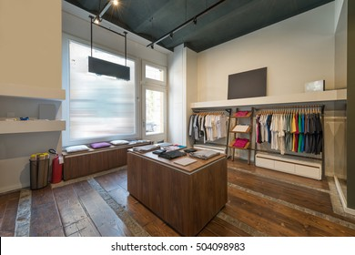 Interior of modern urban fashion clothes t-shirt store