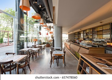 Interior of a modern urban restaurant with concrete floor