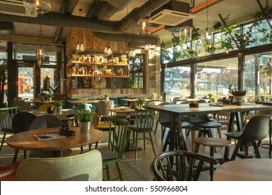 Interior of a modern urban restaurant in the morning sunlight