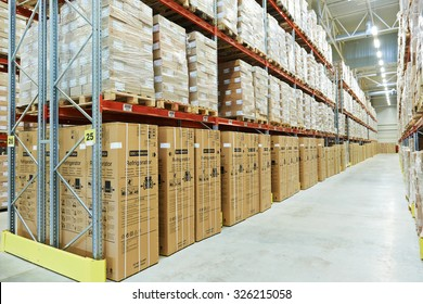 interior of modern warehouse. Rows of shelves with boxes