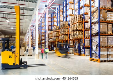 Interior of a modern warehouse in time with the staff