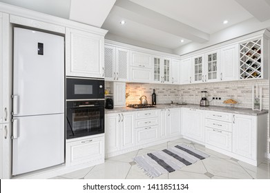interior of modern white wooden kitchen in luxury home