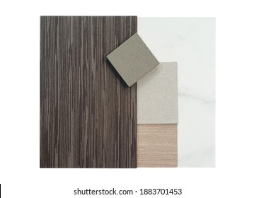 interior mood and tone of material board containing grey walnut veneer wood ,fabric and oak wood laminated ,artificial stone and marble tile samples isolated on white background with clipping path.