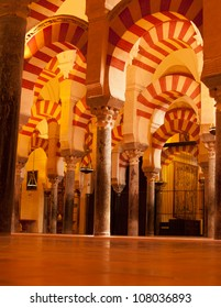 interior of Mosque (Mezquita) cathedral of Cordoba, Spain in candlelight