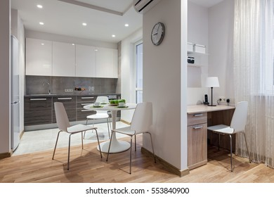 Interior of a new modern apartment in scandinavian style with kitchen and workplace