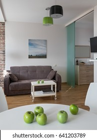 Interior of a new modern apartment in scandinavian style with green apples. NOTE: PHOTO ON THE WALL WAS MADE AND PRINTED BY ME!!!
