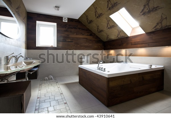 Interior of new modern bathroom in daylight