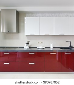 Interior of a new modern red kitchen