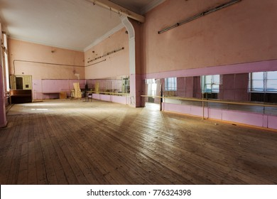 interior of old abandoned Gym for ballet training. An old abandoned ballet studio, an impostor class. abandoned gym of Soviet building of times  interior of an old abandoned building. Ballet room