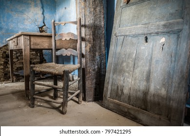interior of an old abandoned house with furniture in place
