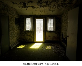 Interior of an old abandoned house. Natural light.