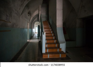 interior of an old abandoned mansion, rooms are abandoned by people, a lot of garbage, old furniture and antiquities destroyed, rooms need repair, old dust and dirt stairs, windows, door to the estate