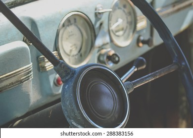 The interior of the old car - the steering wheel and dashboard