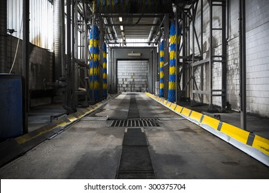 The interior of an old, dirty bus wash building