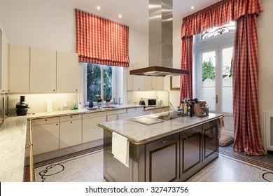 Interior of an old mansion, wide modern kitchen