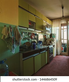 Interior of an old and messy kitchen during day.