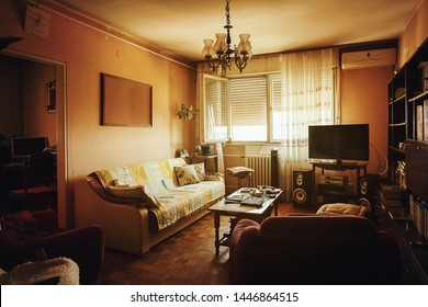 Interior of an old and retro style living room during day.