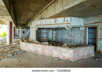 The interior of an old ruined hotel.