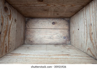 Interior of and old wooden box. Shot inside with wide angle