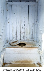 interior of an old wooden outhouse