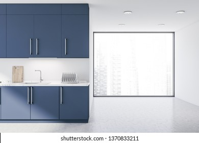 Interior of original kitchen with white walls, large window with cityscape and blue worktop with built in sink. Dark blue cabinets. 3d rendering