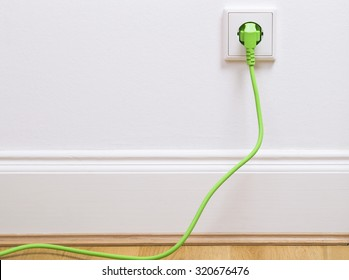 Interior outlet with a green plugged in cable
