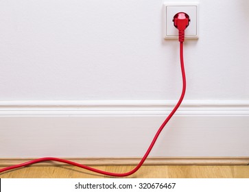 Interior outlet with a red plugged in cable