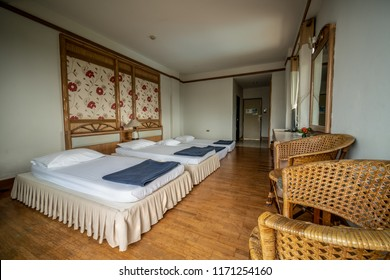interior perspective of six hotel bedroom with two double beds and two twin beds for six persons at Samed Cabana Samed island Rayong district Thailand