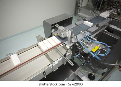 interior of a pharmaceutical industry equipment for packing pills boxes