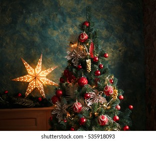 Interior photo of christmas tree with red and yellow decorations