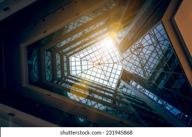 Interior photo of modern building atrium with shining sun