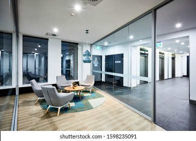 Interior photography of a corporate fit out reception waiting area looking out to entrance and lift lobby in office building