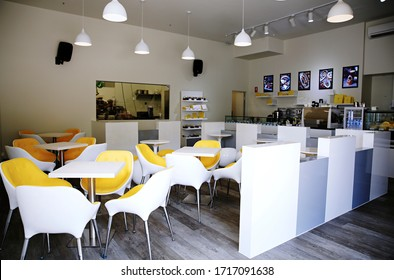 Interior photography of a modern chocolatier's chocolate shop and cafe with counter display and tables and chairs