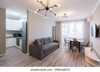 Interior photography, modern living room with kitchen studio, loft style, in bright colors