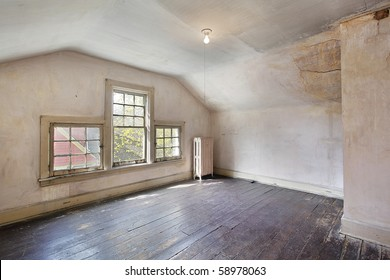 Interior of a pink bedroom in an old abandoned home