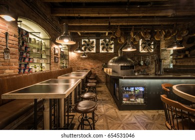 Interior of pizza restaurant with wood fired oven
