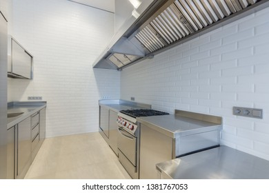 Interior of professional kitchen. Work tables, sinks, cupboards