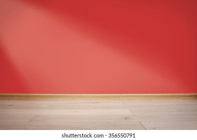 Interior with red wall and wooden floor