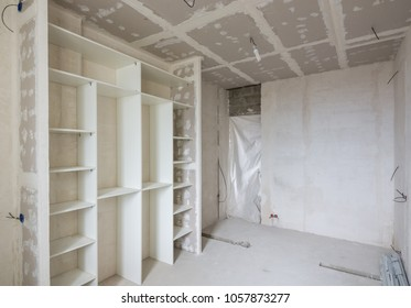 Interior of the renovated room with built-in wardrobe