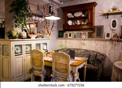 Interior of restaurant in country style. cozy restaurant in French style with empty frames for paintings and photographs on walls