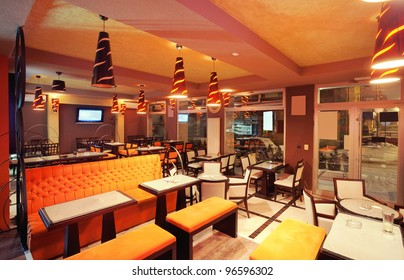 Interior of a restaurant, modern design in few colors, orange and ...