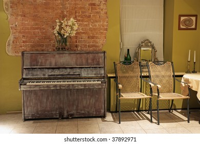 Interior of restaurant with the old piano
